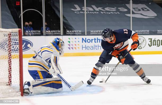 Mathew Barzal of the New York Islanders scores at 3:51 of the second period against Carter Hutton of the Buffalo Sabres at the Nassau Coliseum on...