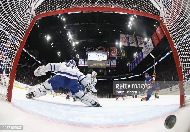 Mathew Barzal of the New York Islanders scores his first period goal against Frederik Andersen of the Toronto Maple Leafs at NYCB Live's Nassau...