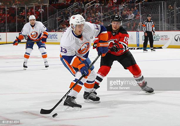 Mathew Barzal of the New York Islanders skates against the New Jersey Devils at the Prudential Center on October 5 2016 in Newark New Jersey