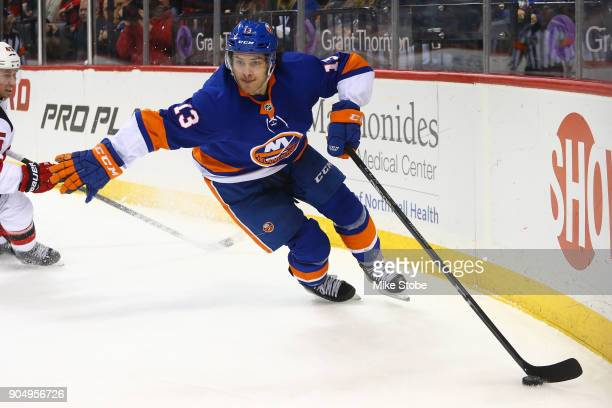 Mathew Barzal of the New York Islanders skates against the New Jersey Devils at Barclays Center on January 7 2018 in New York City New York Islanders...