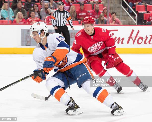Mathew Barzal of the New York Islanders skates in front of Anthony Mantha of the Detroit Red Wings during an NHL game at Little Caesars Arena on...