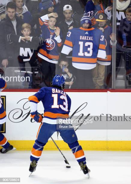 Mathew Barzal of the New York Islanders skates in warmups prior to the game against the Boston Bruins at the Barclays Center on January 18 2018 in...