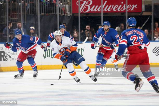 Mathew Barzal of the New York Islanders skates with the puck against the New York Rangers at Madison Square Garden on January 13 2018 in New York City