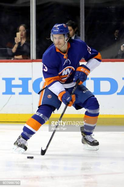 Mathew Barzal of the New York Islanders skates with the puck against the New York Rangers in the first period during their game at Barclays Center on...