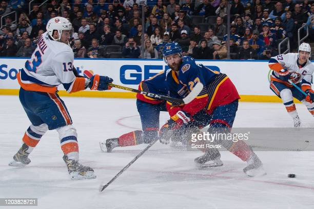 Mathew Barzal of the New York Islanders takes a shot as Alex Pietrangelo of the St Louis Blues defends at Enterprise Center on February 27 2020 in St...