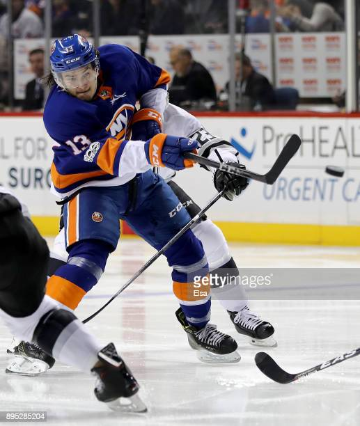 Mathew Barzal of the New York Islanders takes a shot as Dustin Brown of the Los Angeles Kings defends on December 16 2017 at Barclays Center in the...