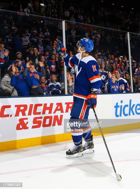 Mathew Barzal of the New York Islanders tosses a puck to the fans after his teams 53 win over the Philadelphia Flyers at NYCB Live's Nassau Coliseum...