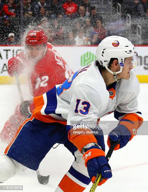 Mathew Barzal of the New York Islanders turns up ice spraying Patrik Nemeth of the Detroit Red Wings with snow during the third period at Little...