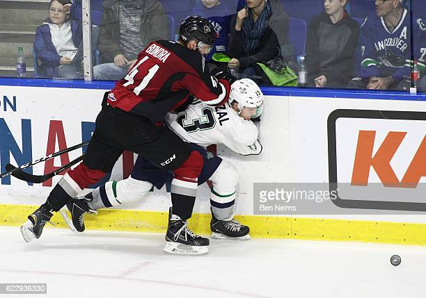 Mathew Barzal of the Seattle Thunderbirds is checked by Radovan Bondra of the Vancouver Giants during the third period of their WHL game at the...