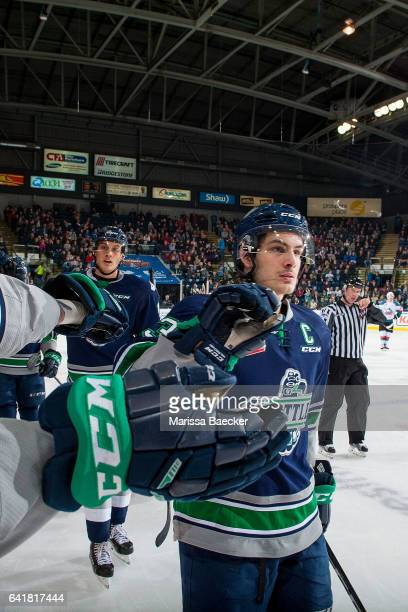 Mathew Barzal of the Seattle Thunderbirds skates by the bench to celebrate a goal by fist bumping teammates against the Kelowna Rockets on February...