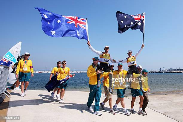 Mathew Belcher and Malcolm Page of Australia are welcomed onshore by team mates after winning gold in the Men's 470 Sailing on Day 14 of the London...
