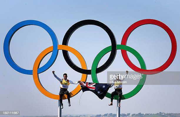 Mathew Belcher and Malcolm Page of Australia celebrate in the Olympic rings after winning gold in the Men's 470 Sailing on Day 14 of the London 2012...