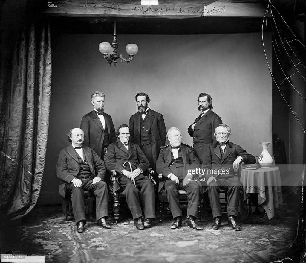 Mathew Brady studio portrait of the House of Representatives' impeachment committee of President Andrew Johnson in 1868. Left to right (standing) are James F. Wilson, George S. Boutwell, and John A. Logan. Seated are (left to right) Benjamin F. Butler, Thaddeus Stevens, Thomas Williams, and John A. Bingham.