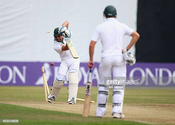 Mathew Christensen of South Africa is clean bowled by Luke Wood of England during day two of the second test match between England U19's and South...