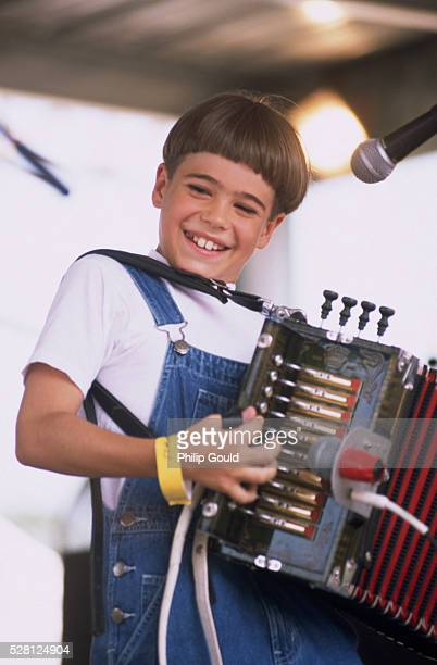 mathew courville playing accordion - accordionist stock pictures, royalty-free photos & images