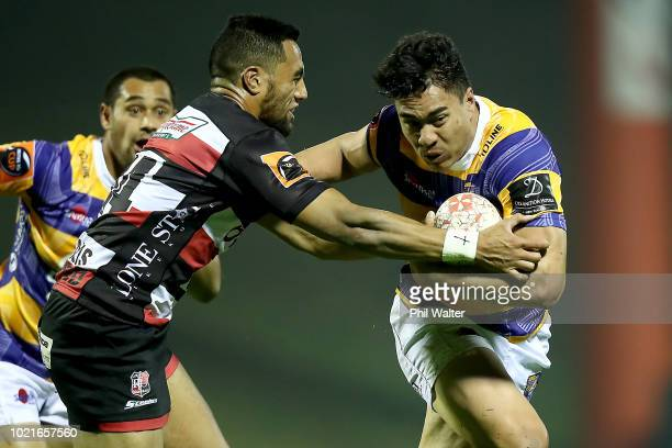 Mathew Garland of Bay of Plenty is tackled by Sione Molia of Counties during the round two Mitre 10 Cup match between Counties Manukau and Bay of...