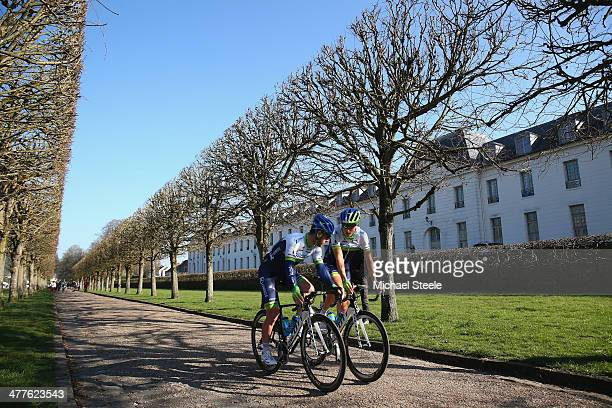 Mathew Goss of Australia and Orica Greenedge chats to Jens Keukeleire of Germany as they head towards the start of Stage Two of the Paris- Nice race...