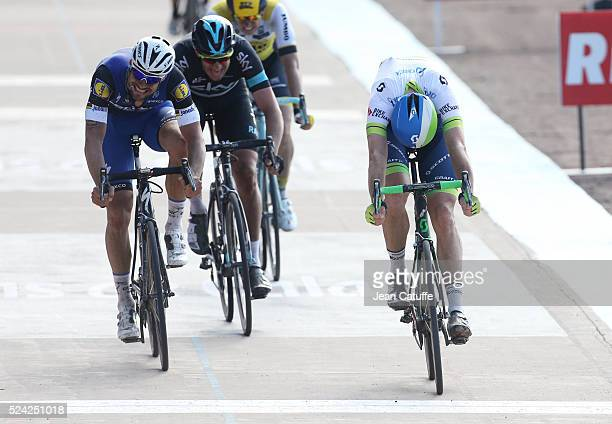 Mathew Hayman of Australia and Orica GreenEDGE wins in front of Tom Boonen of Belgium and EttxxQuick Step and Ian Stannard of Great Britain and Team...