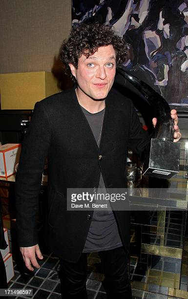 Mathew Horne attends an exclusive preview of the 'Thomas Campbell Paints Lily and Lionel' collection of wearable art in association with the English...