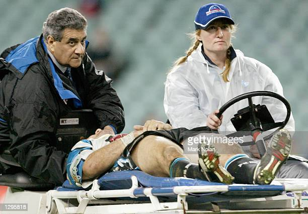 Mathew Johns of the Sharks is stretchered from the field after being injured during round 21 of the NRL between the Sydney Roosters and the Cronulla...