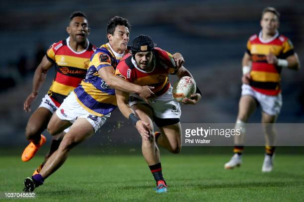 Mathew Landsdown of Waikato is tackled during the round six Mitre 10 Cup match between Bay of Plenty and Waikato at Rotorua International Stadium on...