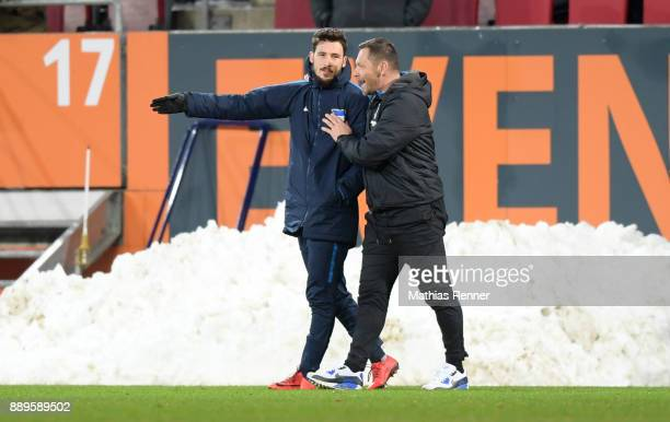 Mathew Leckie and coach Pal Dardai of Hertha BSC after the game between dem FC Augsburg and Hertha BSC on december 10 2017 in Augsburg Germany