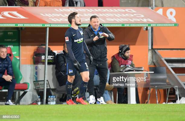 Mathew Leckie and coach Pal Dardai of Hertha BSC during the Bundesliga match between FC Augsburg and Hertha BSC on December 10 2017 in Augsburg...