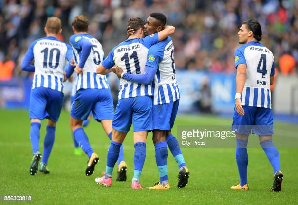 Mathew Leckie and Salomon Kalou of Hertha BSC celebrate after scoring the 2:2 during the game between Hertha BSC and FC Bayern Muenchen on october 1,...