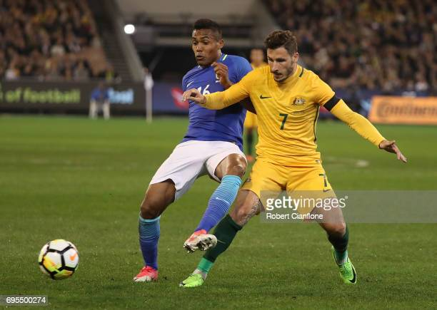Mathew Leckie of Australia and Alex Sandro Silva of Brazil compete for the ball during the Brasil Global Tour match between Australian Socceroos and...