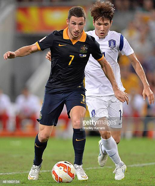 Mathew Leckie of Australia breaks away from the defence during the 2015 Asian Cup match between Australia and Korea Republic at Suncorp Stadium on...