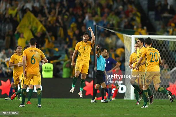Mathew Leckie of Australia celebrates after scoring his teams first goal during the international friendly match between the Australian Socceroos and...