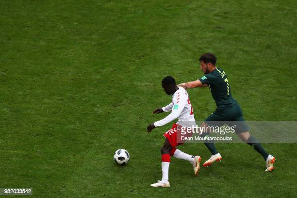 Mathew Leckie of Australia chases Pione Sisto of Denmark during the 2018 FIFA World Cup Russia group C match between Denmark and Australia at Samara...
