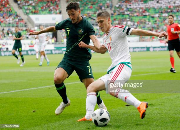 Mathew Leckie of Australia competes for the ball with Roland Sallai of Hungary during the International Friendly match between Hungary and Australia...