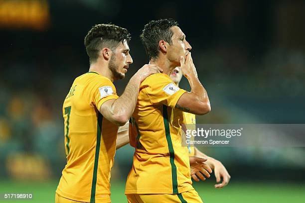 Mathew Leckie of Australia congratulates team mate Mark Milligan of Australia after kicking a penalty goal during the 2018 FIFA World Cup...