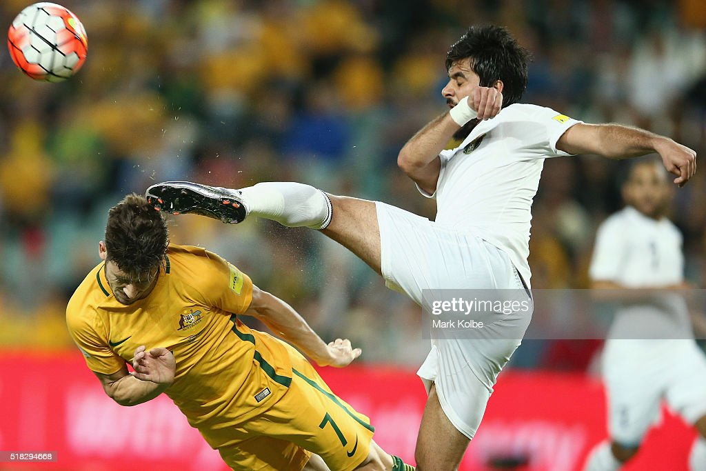 Mathew Leckie of Australia dives to head the ball as it is cleared by Mohammad Al Basha of Jordan during the 2018 FIFA World Cup Qualification match between the Australian Socceroos and Jordan at Allianz Stadium on March 29, 2016 in Sydney, Australia.