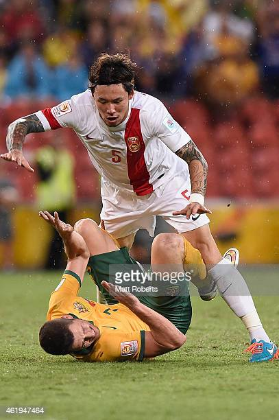 Mathew Leckie of Australia is tackled by Zhang Linpeng of China PR during the 2015 Asian Cup match between China PR and the Australian Socceroos at...