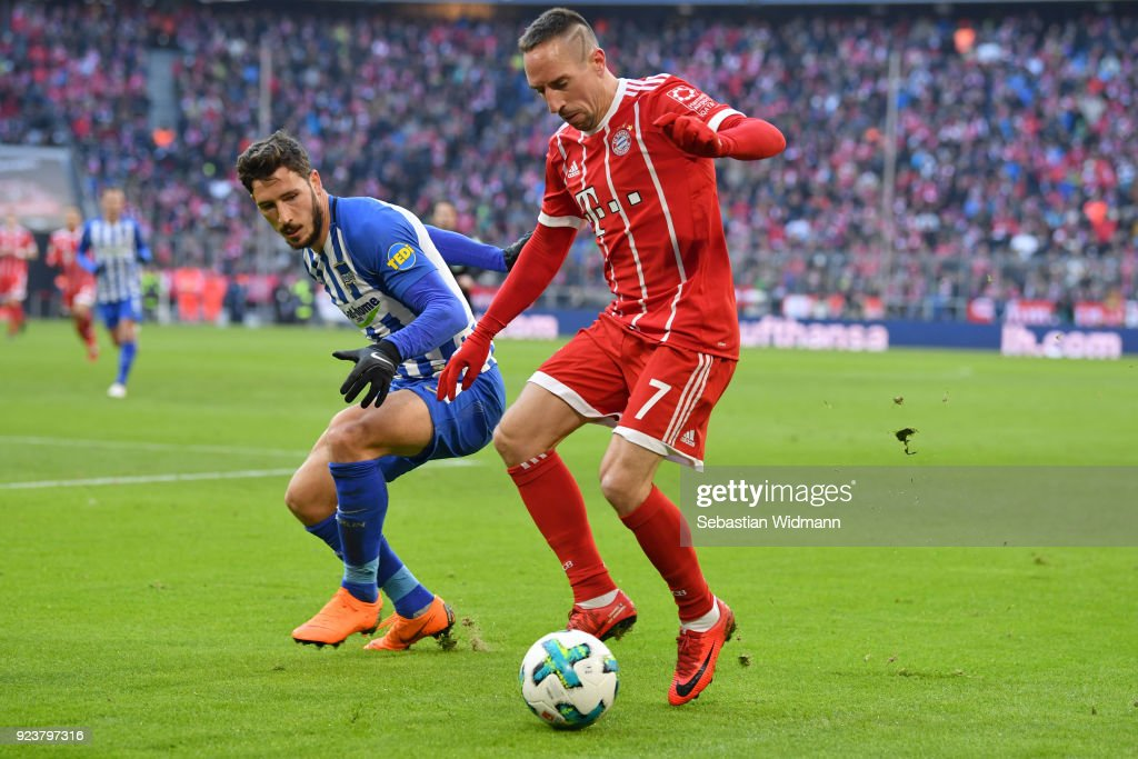 Mathew Leckie of Berlin and Franck Ribery of Bayern Muenchen compete for the ball during the Bundesliga match between FC Bayern Muenchen and Hertha BSC at Allianz Arena on February 24, 2018 in Munich, Germany.