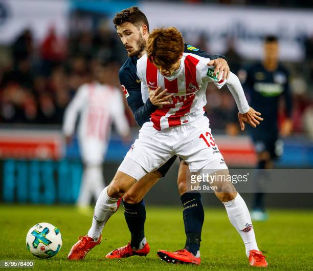Mathew Leckie of Berlin challenges Yuya Osako of Koeln during the Bundesliga match between 1 FC Koeln and Hertha BSC at RheinEnergieStadion on...