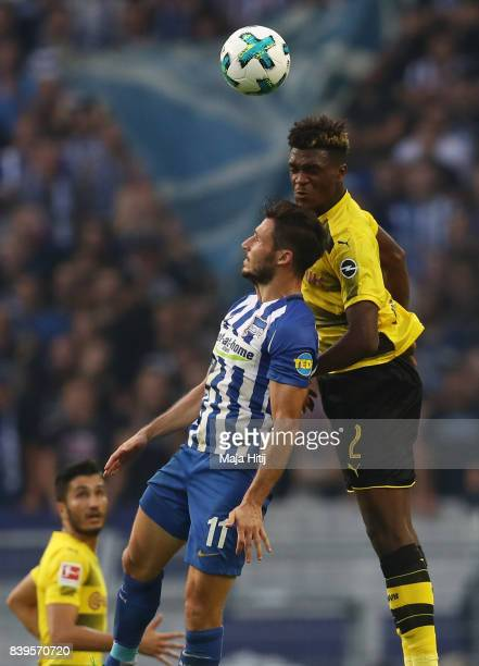 Mathew Leckie of Berlin fights for the ball with DanAxel Zagadou of Dortmund during the Bundesliga match between Borussia Dortmund and Hertha BSC at...