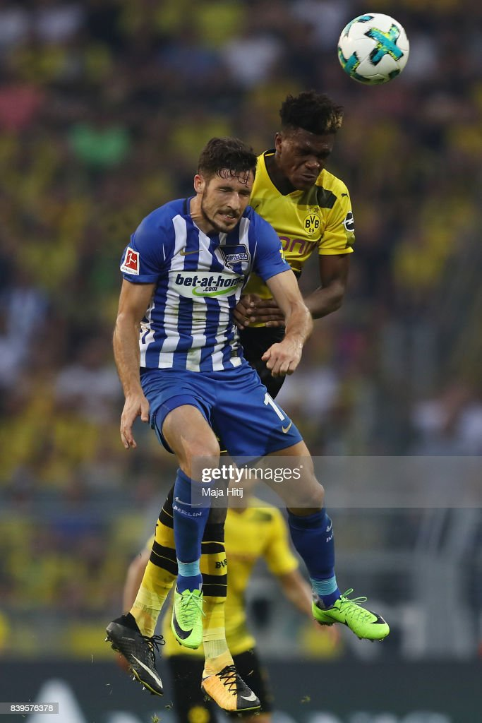 Mathew Leckie of Berlin (l) fights for the ball with Dan-Axel Zagadou of Dortmund during the Bundesliga match between Borussia Dortmund and Hertha BSC at Signal Iduna Park on August 26, 2017 in Dortmund, Germany.