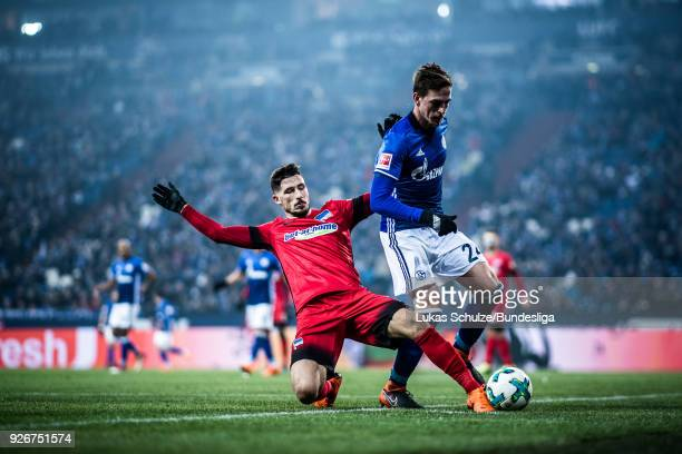 Mathew Leckie of Berlin tackles Bastian Oczipka of Schalke during the Bundesliga match between FC Schalke 04 and Hertha BSC at VeltinsArena on March...