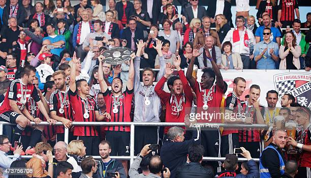 Mathew Leckie of FC Ingolstadt and team mates celebrate the winning the shield after the 2 Bundesliga match between FC Ingolstadt and RB Leipzig at...