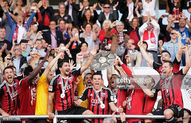 Mathew Leckie of FC Ingolstadt and team mates celebrate the winning the shield after the 2. Bundesliga match between FC Ingolstadt and RB Leipzig at...