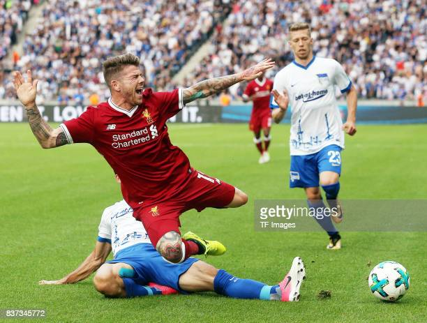 Mathew Leckie of Hertha and Alberto Moreno of Liverpool battle for the ball during the Preseason Friendly match between Hertha BSC and FC Liverpool...