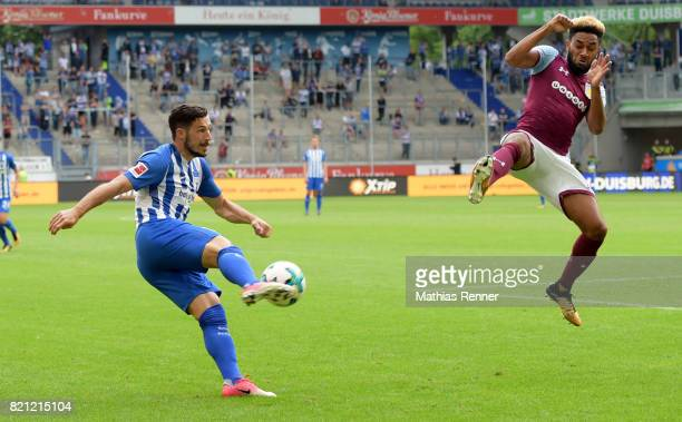 Mathew Leckie of Hertha BSC and Aaron Tshibola of Aston Villa during the game between Aston Villa and Hertha BSC on july 23 2017 in Duisburg Germany