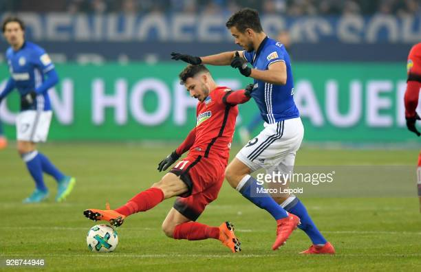 Mathew Leckie of Hertha BSC and Franco Di Santo of FC Schalke 04 during the first Bundesliga match between Schalke 04 against Hertha BSC at the...
