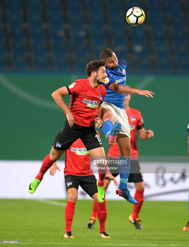 Mathew Leckie of Hertha BSC and Marcel Ziemer of FC Hansa Rostock during the game between FC Hansa Rostock and Hertha BSC on August 14, 2017 in Rostock, Germany.