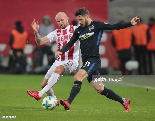 Mathew Leckie of Hertha BSC Berlin and Konstantin Rausch of Koeln battle for the ball during the Bundesliga match between 1 FC Koeln and Hertha BSC...
