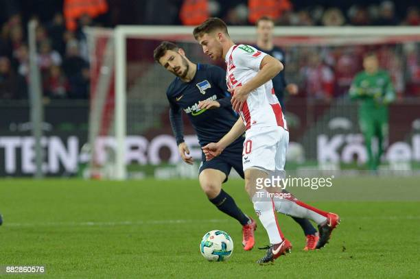 Mathew Leckie of Hertha BSC Berlin and Salih Oezcan of Koeln battle for the ball during the Bundesliga match between 1 FC Koeln and Hertha BSC at...