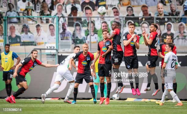 Mathew Leckie of Hertha BSC Ramy Bensebaini of Borussia Moenchengladbach Per Skjelbred Niklas Stark Dodi Lukebakio Krzysztof Piatek Matheus Cunha...